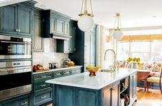 Get Inspired by This Gorgeous Brass and Blue Kitchen via @mydomaine