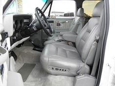 Interior of the white 4x4, converted to grey leather seats and console from a 95-98 full size chevy.  The door panels and remainder of the interior look amazingly restored