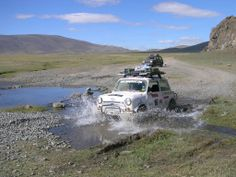 The Mongol Rally. Got to be done. Imagine, you're lost in a massive desert, hundreds of miles from civilisation, driving a car your granny would be embarrassed by. Your car needs an engine size of less than 1.2 Ltr, thats the rules. This is to make sure you have an adventure. Motorbikes need to be under 125cc. You cover 10,000 miles of pure adventure over mountains, deserts and some of the most remote terrain on the planet, totally unsupported. Looks awesome.