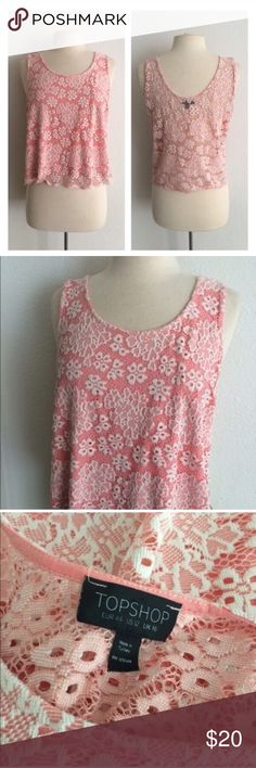 """Topshop pink tank Topshop pink lace top. Size 12. Measures 22"""" long with a 40"""" bust. This has a bit of stretch to it. The body is 52% polyester/ 48% polyamide and the lining is 100% viscose. The back is sheer. EUC. **This is the same top worn by Daphne on Switched at Birth!   🚫NO TRADES🚫 💲Reasonable offers accepted💲 💰Ask about bundle discounts💰 Topshop Tops Tank Tops"""