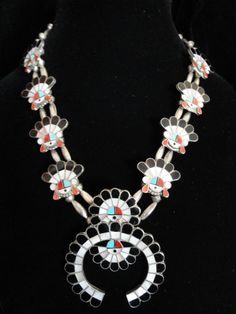 Sun Face Squash Blossom Necklace | Unknown Zuni Artist.  Sterling silver, inlaid with coral, turquoise, jet and mother of pearl.