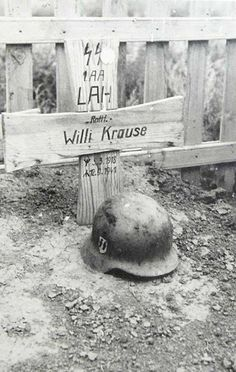 Grave of German SS Corporal Willi Krause. He was a soldier from the SS Panzer-Division Leibstandarte (LSSAH or LAH). You can make out the blood stains on his helmet. German Soldiers Ww2, German Army, Nagasaki, Hiroshima, Germany Ww2, Ww2 Pictures, German Uniforms, War Photography, Fukushima