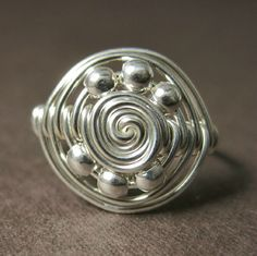 Wire Wrapped Ring Sterling Silver Saturn by holmescraft on Etsy, $23.00