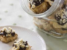 Alton Brown shares his recipe for chocolate-dipped coconut macaroons. Watch on ulive