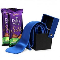 Love that gentleman look on the man of your life? Then buy him this special Gentleman gift duo that includes one elegant blue colored tie and 2 Dairy Milk Silk (Almond) chocolates of 60 grams each. Dairy Milk Silk, Gift Hampers, Online Gifts, Corporate Gifts, Gentleman, Best Gifts, Day, Stuff To Buy, Delivery