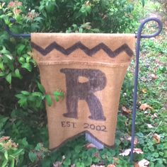 Garden flag  Made this while dinner was cooking.  Burlap, hot glue, needle & thread if desired, permanent marker and scissors.  #gardenflag #bunting #burlap #flag #monogram #chevron