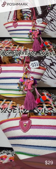 """NWT! BUNDLE! LITTLE GALS PURSE&CHARM KEYCHAIN ! NWT! NEW! LITTLE GALS PURSE & HAND MADE BAG CHARM KEYCHAIN DECORATION! This is so cute for the little gals! Woven colorful bag. Lined inside with comparments & zipper pockets. Snap closure. Hand made bag charm keychain decoration by CCD with elephant tassel, pom pom dangle & beaded dangle. Both items BRAND NEW! Bundle deal! Big gals may like this too!! This bag is adorable!! Bag is made from paper/cotton & poly. 11"""" x 7"""" CCD Accessories Bags"""