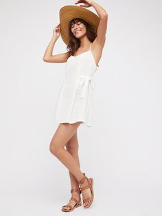 Melt Your Heart Mini Dress | Fit and flare mini dress featuring a strappy back.    * Adjustable waist tie   * Hip pockets