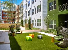 Grab a book and relax in the courtyard at AMLI at Mueller, apartments in Central Austin.