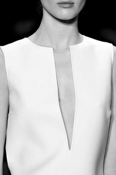 PLUNGING NECKLINE. Low-cut neckline, usually V-shaped, extending to the level of the breasts or to the waist. Lower than decollete.