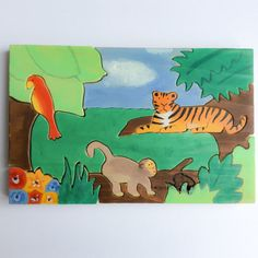 This lovely wooden puzzle of a jungle scenery is made from solid pine wood and consists of 12 parts. Children can take the tiger, the monkey and the parrot out of the puzzle to play with them separately. The puzzle has been hand drawn by myself. It has then been hand cut by scroll saw, painted with non-toxic paint and varnished with an organic varnish (all certified toy safe). All the pieces have been sanded and the edges rounded to make it soft for childrens little hands. All the wood comes…