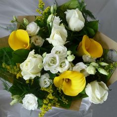 A cheerful bouquet of yellow Calla Lilies with white Roses and seasonal flowers.  Part of Mothers Day 2016 Collection.
