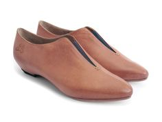 """While humankind has been busy building civilizations around water, John has been equally busy building a shoe around the core element. The Water is a smooth, slip-onbootie with a 1.25"""" heelmade with soft, natural leathers and a hint of elastic that needs no bells or whistles to communicate its fundamental essence. You won't need to drink eight glasses of this Water per day, but wearing it on a regular basis will provide ample nourishment for the mind and soul. You have the power."""