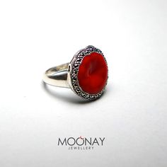 Sterling silver ring with red enamel on it.