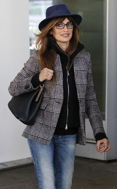 Penelope Cruz dressed for autumn, flaunting a navy fedora, a plaid jacket 'n' jeans, not to mention quirky rectangular specs!