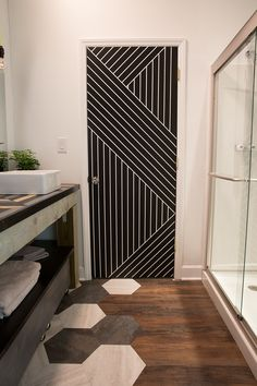 Plain door painted with an awesome design using just paint and painters tape