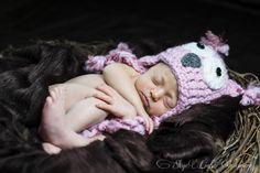 Adorable baby in nest with owl hat. www.skyelightimagery.ca