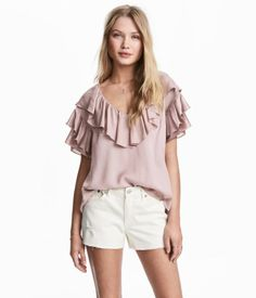 White. Short-sleeved top in woven fabric. V-neck with ruffle at edge, ruffles on shoulders, and overlocked edges.
