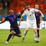 Nigel de Jong of the Netherlands (L) vies with Fernando Torres of Spain