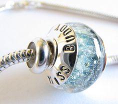 Cremation jewelry.  Artisan memorial keepsake snake chain bracelet. Sterling silver & boro glass. Custom text. Pet or human ashes.. $140.00, via Etsy.