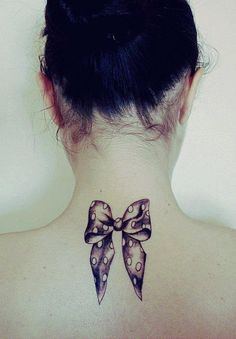 Bow tattoo, on the back of my thighs with corset ribbon going down to my knee