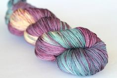 Only one available - ready to ship. This hank is discounted due to one knot in it. SILK SOCK sock/fingering weight - 4 ply 75% ultrafine superwash merino/ 25% mulberry silk 100 g 437 yards    Mix of silver grey, turquoise, with hints of purples and brown accents. Will knit up as a variegated with beautifully heathered, textured look. Dyed with acid dyes. Colorfast.  NOTE: Color darkness or shades may vary based on viewing device settings. If you are unsure about the displayed photos...