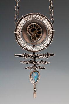 Pendant | Una Barrett ~ Relics Of A New Age. 'Ammonite's Cradle Talisman'  Sterling silver, copper and aquamarine.