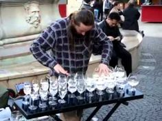 Man playing wine glass music on the street