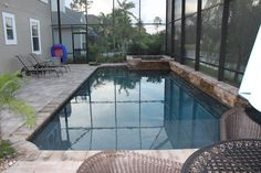 Simple rectangle pool with corner hot tub