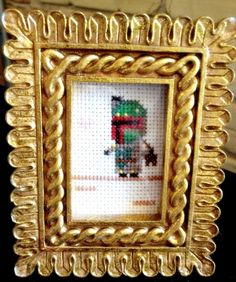 Star Wars Boba Fett cross stitch -- AAAUGH!  I have to have this.  Related, I also need to learn to cross stitch.