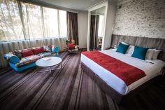Recently refurbished, the corner suites at Sydney Central, reflect Surry Hills quirky style. Surry Hills, Penthouses, Sydney, Corner, Bed, Furniture, Home Decor, Style, Mulches