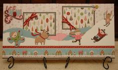 Cute layout from Monique Griffith Design using the Winter Frolic Cricut cartridge.