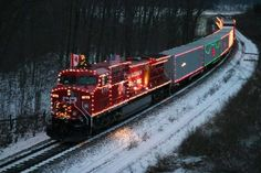 "Trains with christmas lights | Christmas Train  | Visit ""Believe in the Magic of Christmas"" on Pinterest"
