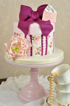 For a special birthday we created with sweet vintage -inspired violet and peony hat box cake!