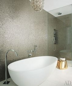 Simple white tub and subtle metallic mosaics