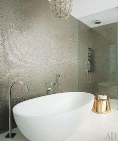 Simple white tub and subtle metallic mosaics