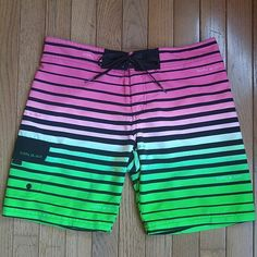 Body Glove Board Shorts Pink, green, and black design board shorts from Body Glove. Size XS. Front lace up detail and convenient side cargo pocket. Super lightweight and comfortable. Excellent used condition, only wore these once or twice. Body Glove Shorts