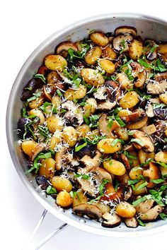 This Toasted Gnocchi with Mushrooms, Basil and Parmesan recipe only takes about 30 minutes to prepare, it's nice and hearty, and full of absolutely delicious flavors! | http://gimmesomeoven.com (Gluten-Free / Vegetarian)