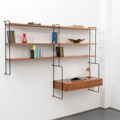 <p><span>Modular Omnia rack in teak, metal and brass for Hilker from the 60s. Teak structure on black metal ladders. Consists of 1 desk, 2 drawers with brass handles and 3 shelves. In good vintage condition, some marks of wear.</span></p>