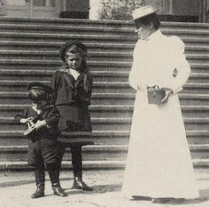 Grand Duchess Maria Nikolaevna and her little brother Tsarevich Alexei with a lady-in-waiting