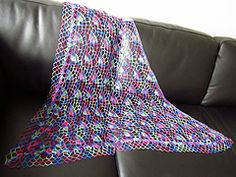 Ravelry: Festival Shawl pattern by Lyn Robinson.  Free pattern download suitable for advanced beginner to intermediate crochet skills.