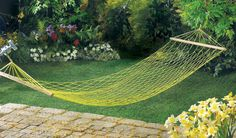 I really like this hammock. The yellow netting matches all of the yellow flowers so well. It also compliments the bright green grass. It also looks like it is in the perfect spot to lay out and get some sun. I would love to hang a hammock above my patio like this.