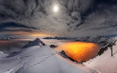 Gianmaria Veronese uncovered this spectacular setting as the moon and clouds light up the snow. Taken at Mount Valgussera during a winter night in Italy. Looks like a Volcano by Gianmaria Veronese Wallpaper Winter, Sunset Wallpaper, Nature Wallpaper, Hd Wallpaper, Computer Wallpaper, Night Photography, Amazing Photography, Landscape Photography, Mountain Landscape