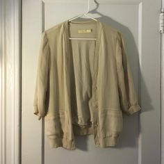 Urban Outfitters Chiffon Cardigan Super cute chiffon cardigan/blazer. Barely worn, barely noticeable pulling on front(see photo). Pockets are still stitched closed! More of an ivory color Urban Outfitters Jackets & Coats Blazers