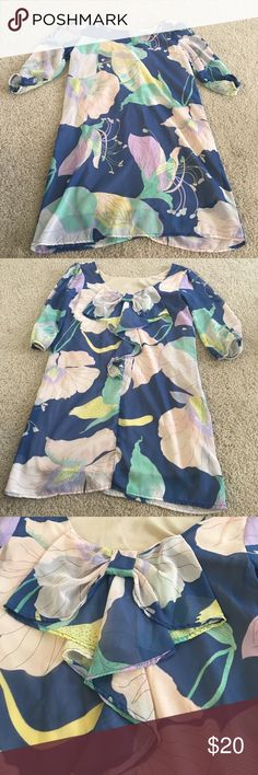 Floral mini dress Pretty flower pattern. Bow detail on back. Chiffon like material. Worn only once Dresses Mini