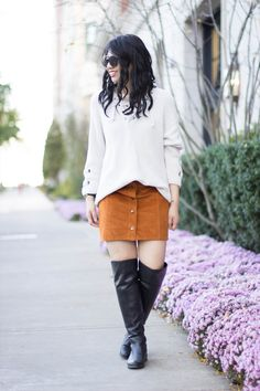 chunky knit sweater, lace up sweater, a-line corduroy skirt with over the knee boots
