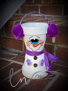 I've decided to keep my adorable hand painted flower pot people photos here. This gives me a place to share the Flower Pots that I've done. Clay Pot Projects, Clay Pot Crafts, Shell Crafts, Cement Crafts, Clay Flower Pots, Flower Pot Crafts, Bunny Crafts, Snowman Crafts, Snowman Ornaments