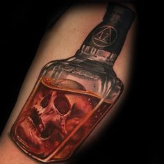 Gentleman With 3d Skull In A Bottle Tattoo On Arm
