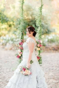 A whimsical swing draped in pastel blooms add to that magical feel of their vintage Cape Town wedding.