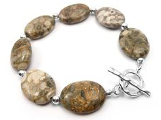 This is a simple sterling silver and fossil crinoid bracelet made from x smooth oval stones that have such wonderful and interesting patterns. Warm Grey, Brown And Grey, Sterling Silver Jewelry, Gemstone Jewelry, Bracelet Making, Fossil, Indigo, Drop Earrings, Gemstones